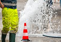 Major burst or water running down the street